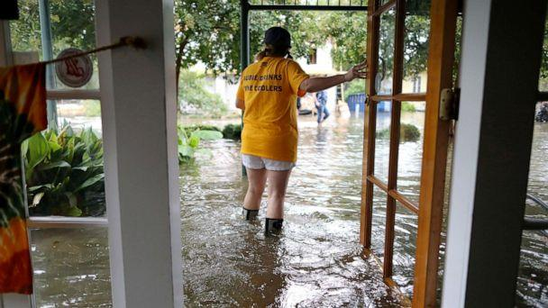PHOTO: Robyn Iacona-Hilbert stands outside her flooded business after Hurricane Barry came ashore in Mandeville, La., on Saturday, July 13, 2019. (Jonathan Bachman/Reuters)