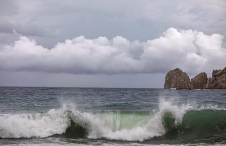 A general view shows waves crashing on the shore of La Empacadora beach in cabo San lucas as Hurricane Lorena churned close to the southern tip of Mexico's Baja California