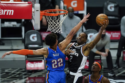 Los Angeles Clippers forward Kawhi Leonard (2) takes a shot against Oklahoma City Thunder forward Isaiah Roby (22) during the first quarter of an NBA basketball game Sunday, Jan. 24, 2021, in Los Angeles. (AP Photo/Ashley Landis)