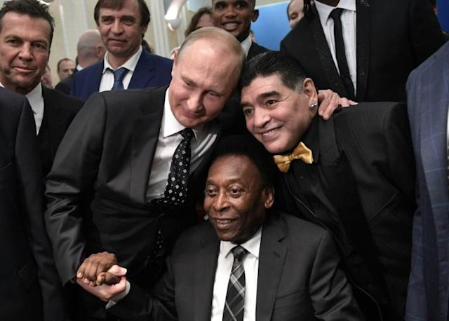 Russian President Vladimir Putin, Brazilian football legend Pele and Argentina's former midfielder Diego Maradona pose for pictures ahead of the Final Draw for the 2018 FIFA World Cup football tournament at the State Kremlin Palace in Moscow on December 01, 2017