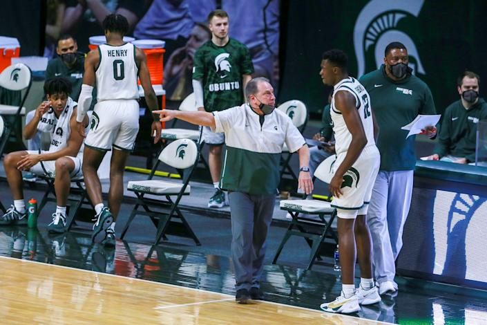 Tom Izzo, Michigan Head coach, talks to Michigan State center Mady Sissoko (22) during the first half against Indiana on Tuesday, March 2, 2021, in East Lansing.