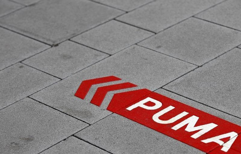 Puma's sign is seen on the street before the company's annual news conference in Herzogenaurach