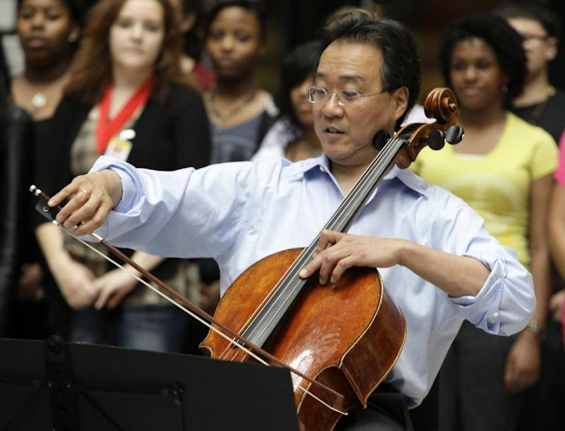 FILE - In this March 19, 2012 file photo, world-famous cellist Yo-Yo Ma plays in the rotunda of the State of Illinois building, the James R. Thompson Center, in Chicago. Yo-Yo Ma and former Guns N' Roses drummer Matt Sorum were on Capitol Hill Tuesday to urge lawmakers to increase funding for the arts in a year of deep federal budget cuts.  (AP Photo/Kiichiro Sato, File)