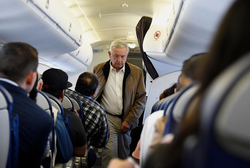 Mexican President Andres Manuel Lopez Obrador boards a commercial flight bound for Culiacan, at Mexico City's international airport, on February 15, 2019. - Anti-establishment Lopez Obrador adpoted aggressive austerity measures for his government, including slashing his own salary, disbanding the presidential security detail and flying commercial airlines for official trips. (Photo by Alfredo ESTRELLA / AFP) (Photo credit should read ALFREDO ESTRELLA/AFP/Getty Images)