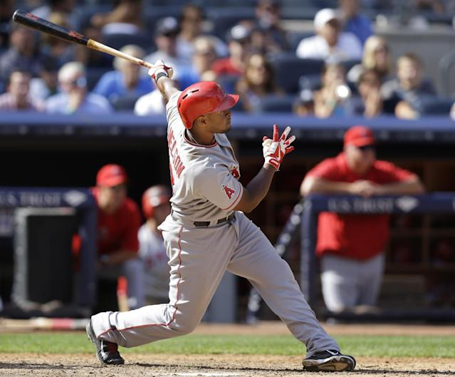 Los Angeles Angels' Chris Nelson follows through on an eighth-inning grand slam off New York Yankees relief pitcher Boone Logan in a baseball game Thursday, Aug. 15, 2013, in New York. Nelson also hit a fourth-inning solo home run. (AP Photo/Kathy Willens)