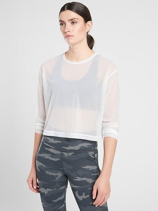 <p>The peek-a-boo <span>Athleta Circuit Top</span> ($39) is made of lightweight mesh so let your favorite sports bra have its moment. </p>