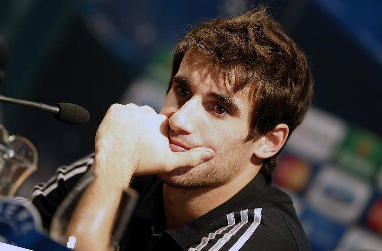 Bayern Munich midfielder Javi Martinez answers questions during a press conference in Valencia on November 19, 2012