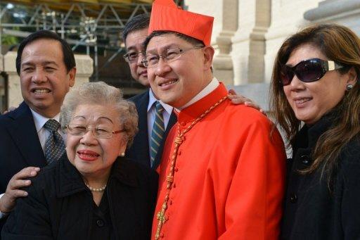 Philippines' Luis Antonio Tagle poses with his family after the ceremony at which he was appointed a cardinal at St Peter's basilica at the Vatican on Saturday., a move welcomed by critics concerned that the body which will elect the future pope is too Eurocentric. AFP PHOTO / VINCENZO PINTO