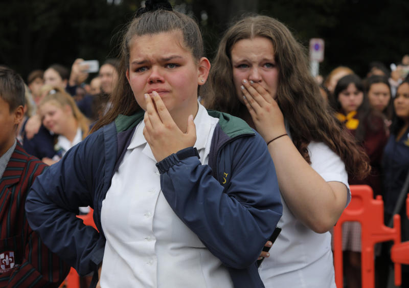 FILE - In this March 18, 2019, file photo, students react as they gather for a vigil to commemorate victims of a shooting, outside the Al Noor mosque in Christchurch, New Zealand. On March 15, 2019, a gunman allegedly fueled by anti-Muslim hatred attacked two mosques in Christchurch, killing 51 people. (AP Photo/Vincent Yu, File)