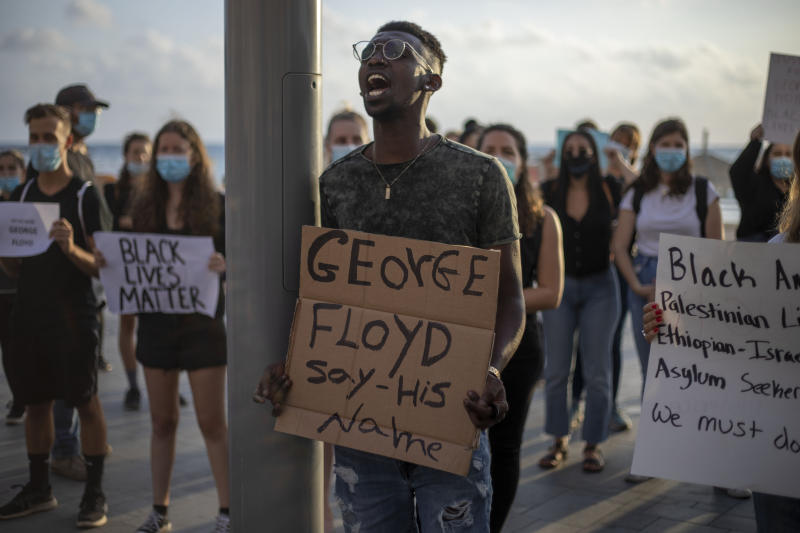 Protesters shout slogans during a protest to decry the killing of George Floyd in front of the American embassy in Tel Aviv, Israel, Tuesday, June 2, 2020. (AP Photo/Ariel Schalit)