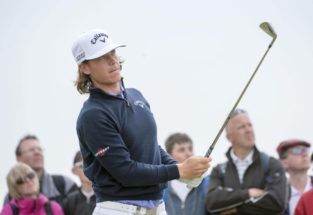 Sweden's Kristoffer Broberg plays a shot off the 6th tee during day three of the Scottish Open at Royal Aberdeen, Aberdeen, Scotland, Saturday July 12, 2014. (AP Photo/PA, Kenny Smith)