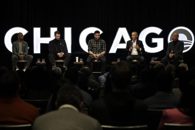 Former President Barack Obama, second from right, talks as Chris Paul, left, of the Oklahoma City Thunder, Kevin Love, second from left, of the Cleveland Cavaliers, Giannis Antetokounmpo, center, of the Milwaukee Bucks, and sports analyst Michael Wilbon listen during a conversation on community impact fireside chat in Chicago, Saturday, Feb. 15, 2020. Obama Foundation to host conversation on community impact with former President Obama and NBA stars. (AP Photo/Nam Y. Huh)