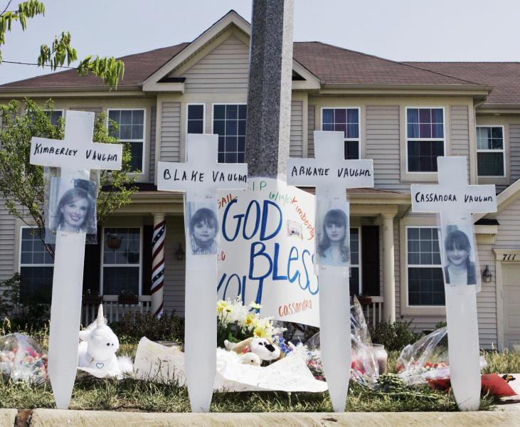 FILE - In this June 15, 2007 file photo, a makeshift memorial to Kimberly Vaughn, and her three children Abigayle, 12, Cassandra, 11, and Blake, 8, is seen outside their home in Oswego, Ill. Christopher Vaughn, who was convicted in the 2007 slayings of his wife and three children, is asking for a new trial and a judge in Joliet, Ill., is expected to announce his decision Tuesday, Nov. 27, 2012. His September trial overlapped with the trial of Drew Peterson, the former suburban Chicago police officer convicted of killing his third wife and whose case had been made into a TV movie. Vaughn's attorney argues that part of the reason his client didn't get a fair trial was because the press conferences held by Peterson's lawyers outside the courthouse damaged his own credibility as a defense attorney. (AP Photo/Charles Rex Arbogast, File)