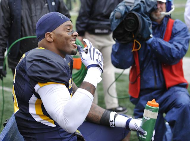 Toledo defensive end Jayrone Elliott smiles on the sideline after returning a fumble for a touchdown during the second quarter of an NCAA college football game against Navy in Toledo, Ohio, Saturday, Oct. 19, 2013. (AP Photo/David Richard)