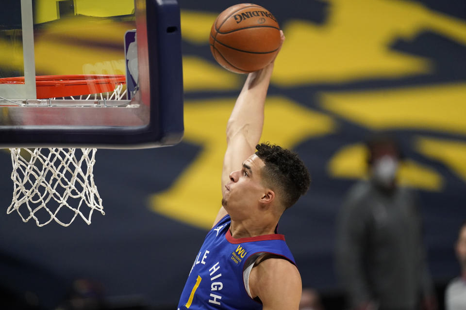 Denver Nuggets forward Michael Porter Jr. dunks against the Brooklyn Nets during the first half of an NBA basketball game Saturday, May 8, 2021, in Denver. (AP Photo/David Zalubowski)