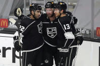 Los Angeles Kings center Jeff Carter, center, celebrates his goal with Andreas Athanasiou (22) and Gabriel Vilardi (13) during the second period of an NHL hockey game against the St. Louis Blues, Friday, March 5, 2021, in Los Angeles. (AP Photo/Marcio Jose Sanchez)