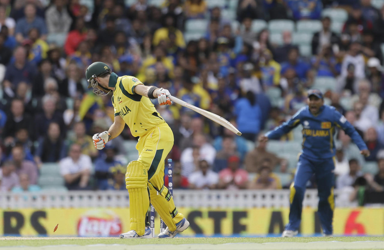 Australia's Glenn Maxwell looks round as he bowled by Sri Lanka's Lasith Malinga during their ICC Champions Trophy cricket match at the Oval cricket ground in London, Monday, June 17, 2013. (AP Photo/Alastair Grant)