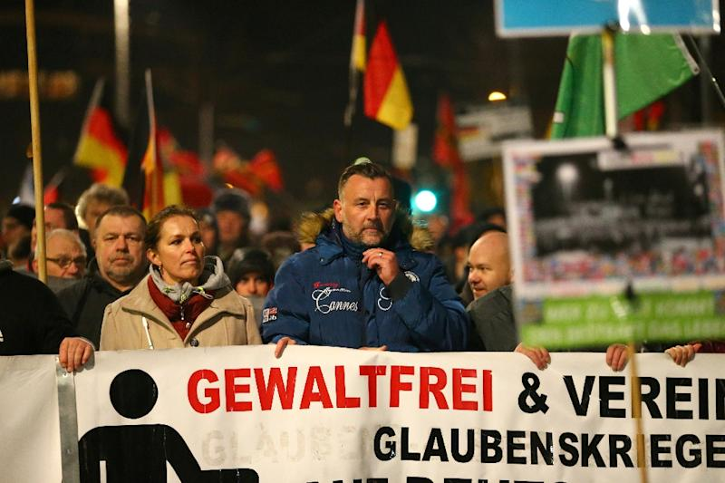 Lutz Bachmann, a leader of the PEGIDA movement (Patriotic Europeans Against the Islamisation of the Occident) speaks to protestors during a rally in Leipzig on March 7, 2016