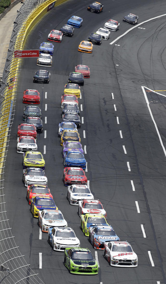 Brad Keselowski, front left, leads the field at the start of the NASCAR Xfinity series auto race at Charlotte Motor Speedway in Charlotte, N.C., Saturday, May 26, 2018. (AP Photo/Chuck Burton)