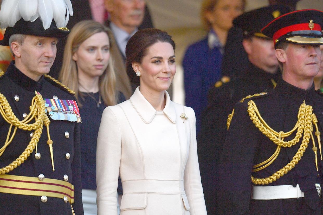 The Duchess of Cambridge watches members of the Massed Bands of the Household Division during the annual Beating Retreat ceremony, which features over 750 soldiers, on Horse Guards Parade, London.