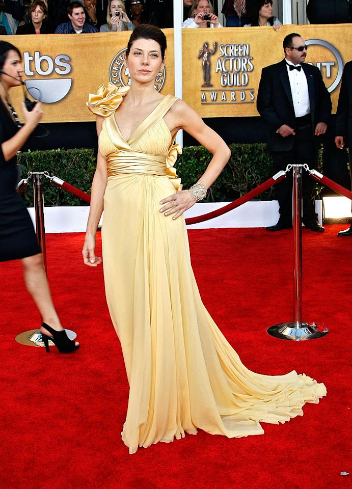 SAG Awards  Grade: C+    Marisa's gold Elie Saab creation could almost work, but there are just too many pleats, too much satin along the waist and straps, and waaaaaay too many ruffles going from the right shoulder down the back to her side.