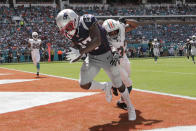 New England Patriots wide receiver Antonio Brown (17) scores a touchdown as Miami Dolphins cornerback Jomal Wiltz (33) attempts to defend, during the first half at an NFL football game, Sunday, Sept. 15, 2019, in Miami Gardens, Fla. (AP Photo/Lynne Sladky)