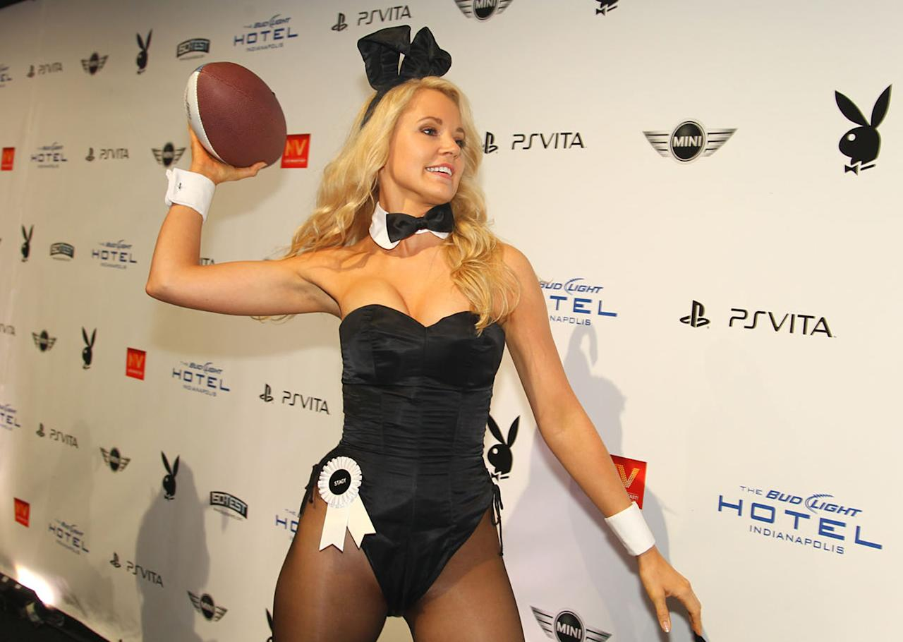 """Playboy's Miss February 1999 Stacy Fuson was ready to play ball on the blue carpet at Playboy's """"Carnival Mystique"""" soiree held at the Bud Light Hotel in Indianapolis on Friday night. She's got a pretty good arm!"""