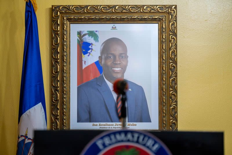 FILE PHOTO: A picture of the late Haitian President Jovenel Moise hangs on a wall before a news conference
