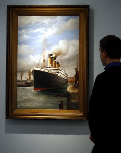 A man looks at a painting of the Titanic by George Fraser, when he saw the ship in Southampton in 1912, on display, at SeaCity Museum in Southampton, England,Tuesday, April 3, 2012. The new museum will open in the City of Southampton on April 10, 100 years after the ill fated Titanic sailed from the City's docks. (AP Photo/Kirsty Wigglesworth)