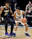 Penn State's Sam Sessoms dibbles around Purdue's Jaden Ivey uring an NCAA college basketball game Friday, Feb. 26, 2021, in State College, Pa. (Abby Drey/Centre Daily Times via AP)