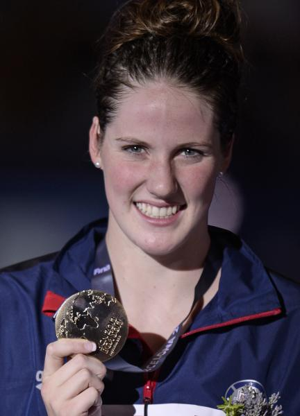 United States's Missy Franklin smiles as she holds the gold medal she won in the Women's 200m freestyle final at the FINA Swimming World Championships in Barcelona, Spain, Wednesday, July 31, 2013..(AP Photo/Manu Fernandez)