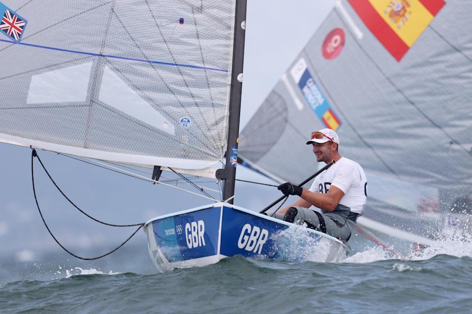 Giles Scott of Team Great Britain competes in the Men's Finn class on day six (Getty)