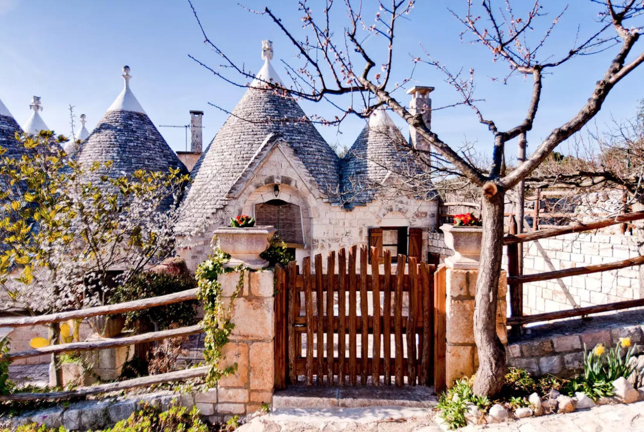"<p>Globe trotters will have to book flights to Italy for a chance to stay in the world's most popular Airbnb. For £64 per night, guests can reside at Sette Coni – which translates to the seven cones – in Ostuni. The stone cottage is located near to must-see tourist hotspots such as the caves of Castellana, the cities of Lecce and Martina Franca and the excavations of Egnazia.<br />According to the listing, it's a perfect location for nature lovers with a traditional patio area sitting pretty beneath an olive tree – we challenge you to find a greater location to read your new book. Don't believe us? A grand total of 164,444 Airbnb users have wish listed the property so far. <strong><a rel=""nofollow"" href=""https://www.airbnb.co.uk/rooms/432044"">Book now</a></strong>. <em>[Photo: Caters]</em> </p>"