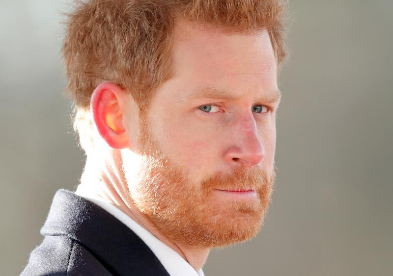 Prince Harry looking into the camera as he attends The Sovereign's Parade at the Royal Military Academy Sandhurst on December 15, 2017 in Camberley, England.