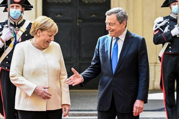 Italy's Prime Minister, Mario Draghi greets German chancellor Angela Merkel upon her arrival for their meeting at Palazzo Chigi in Rome on October 7, 2021. (Photo by Alberto PIZZOLI / AFP) (Photo by ALBERTO PIZZOLI/AFP via Getty Images) (Photo: ALBERTO PIZZOLI via Getty Images)