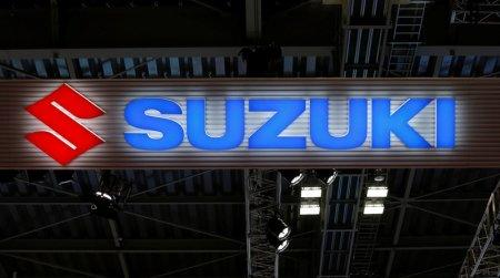 The logo of Suzuki Motor Corp. is pictured at the 45th Tokyo Motor Show in Tokyo, Japan October 25, 2017. Picture taken October 25, 2017. REUTERS/Toru Hanai