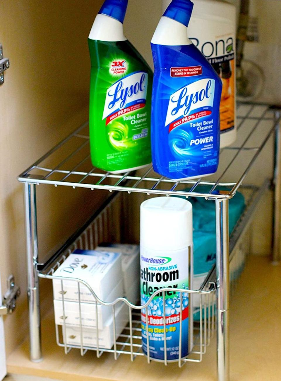 """It featuresa shelf on top so you can double up your storage space — especially great if you have reaaaally small cabinets.<br /><br /><strong>Promising review:</strong>""""These are nice pieces that helped me organize underneath my bathroom sink! They fit perfectly!<strong>After organizing everything, I was so surprised I had so much more room that I grabbed more items out of the linen closet to fill it up.</strong>I still have a lot of room left. I bought these based off the high ratings and they hold true. (This is Brad's wife.)"""" —<a href=""""https://amzn.to/3ahYd4n"""" target=""""_blank"""" rel=""""nofollow noopener noreferrer"""" data-skimlinks-tracking=""""5723569"""" data-vars-affiliate=""""Amazon"""" data-vars-href=""""https://www.amazon.com/gp/customer-reviews/R18X2W0VAIZLRE?tag=bfjasmin-20&ascsubtag=5723569%2C25%2C31%2Cmobile_web%2C0%2C0%2C14870753"""" data-vars-keywords=""""cleaning"""" data-vars-link-id=""""14870753"""" data-vars-price="""""""" data-vars-product-id=""""16022118"""" data-vars-retailers=""""Amazon"""">Brad J. Leahy</a><br /><br /><strong>Get it from Amazon for <a href=""""https://amzn.to/2QclePp"""" target=""""_blank"""" rel=""""noopener noreferrer"""">$26.97</a> (available in two finishes).</strong>"""