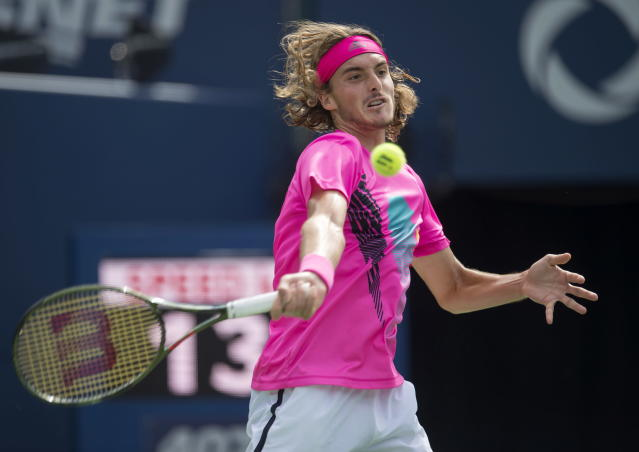 Stefanos Tsitsipas of Greece hits a forehand to Alexander Zverev of Germany during Rogers Cup quarterfinal tennis tournament action in Toronto on Friday, Aug. 10, 2018. (Frank Gunn/The Canadian Press via AP)