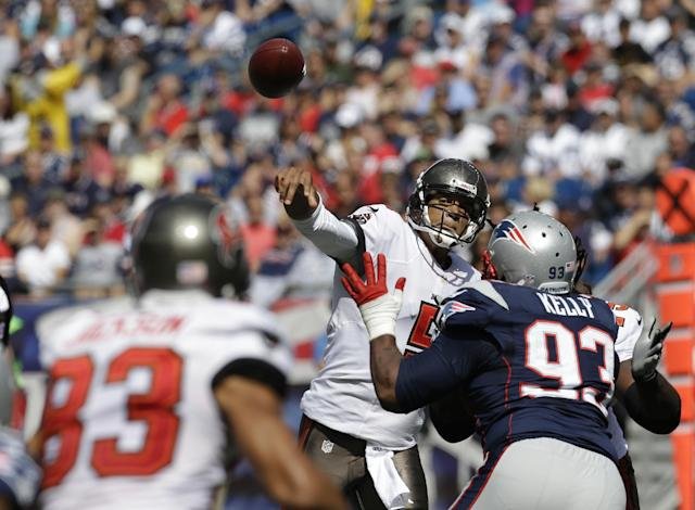 Tampa Bay Buccaneers quarterback Josh Freeman (5) passes over New England Patriots defensive tackle Tommy Kelly (93) to wide receiver Vincent Jackson (83) in the first half of an NFL football game Sunday, Sept. 22, 2013, in Foxborough, Mass. (AP Photo/Stephan Savoia)