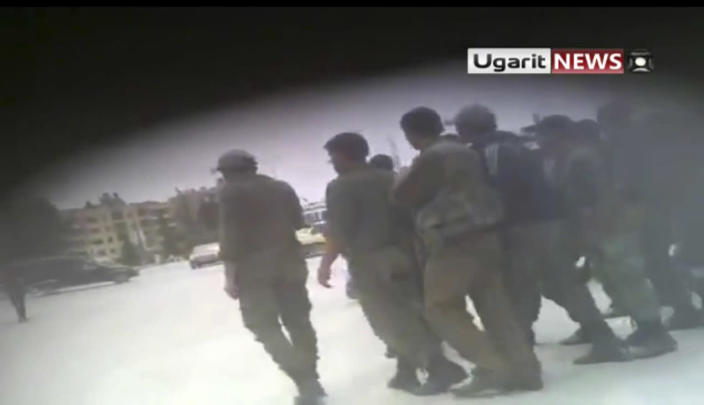 This image made from amateur video released by Ugarit and accessed Thursday, May 3, 2012 purports to show Syrian security forces at Aleppo University in Aleppo, Syria. Syrian security forces stormed dormitories at Aleppo University to break up anti-government protests, killing at least four students and wounding several others in an hourslong rampage that ended Thursday morning and left part of the campus in flames, activists and opposition groups said. (AP Photo/Ugarit via AP video) TV OUT, THE ASSOCIATED PRESS CANNOT INDEPENDENTLY VERIFY THE CONTENT, DATE, LOCATION OR AUTHENTICITY OF THIS MATERIAL