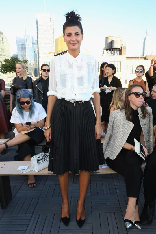 "<p>When in doubt, pair black with white and call it a day. The ""W"" magazine contributor looked polished in a white Comme Des Garcon blouse and a black Junya skirt paired with Paul Andrew shoes and a white crocodile bag from Santiago Gonzalez. </p>"
