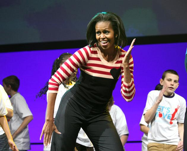 "First Lady Michelle Obama kicks off her three day national tour in Des Moines, Iowa,  Feburary 9, 2012 to highlight Iowa's Healthiest State Initiative.  More than 10,000 children grades 6-9 from Iowa Schools joined The First Lady during the ""Let's Move""  interactive celebration at  Wells Fargo Arena in Des Moines, Iowa.   AFP PHOTO / CONRAD SCHMIDT"
