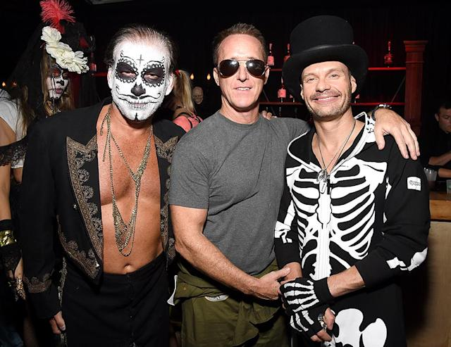<p>Seacrest (right) threw on a skeleton onesie and a top hat for the Casamigos Tequila fiesta, where he partied with peeps including talent manager Geyer Kozinsky (center). (Photo: Michael Kovac/Getty Images) </p>