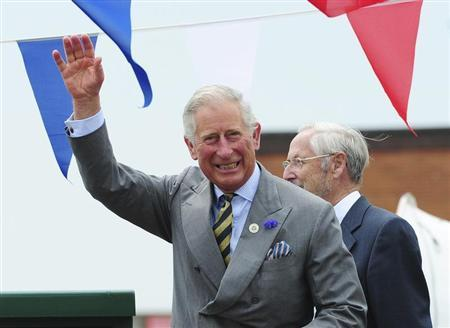 Britain's Prince Charles waves to the crowd during a visit to the harbour in Bridlington