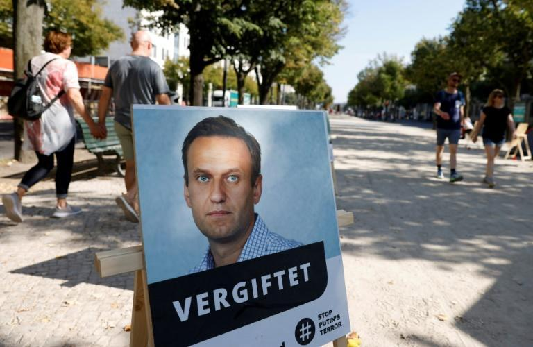 A poster of Navalny with the words 'poisoned'