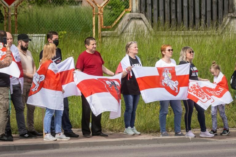 The Belarusian activists held red-and-white opposition flags