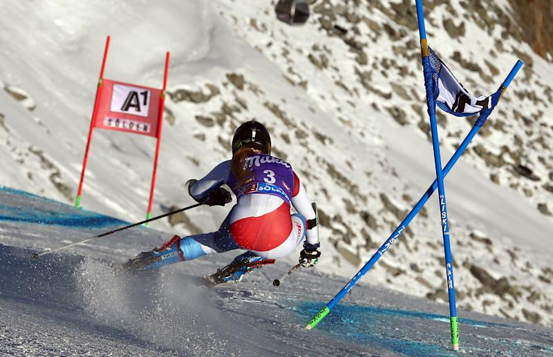 Switzerland's Lara Gut competes on her way to set the fastest time, during the first run of an Alpine ski, women's World Cup giant slalom, in Soelden, Austria, Saturday, Oct. 26, 2013. (AP Photo/Giovanni Auletta)
