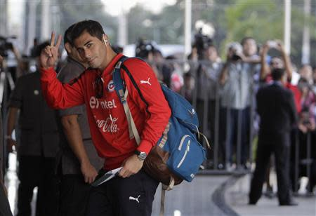 Chile's national soccer team player Herrera arrives at Hotel Bourbon in Luque