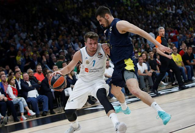 Basketball - Euroleague Final Four Final - Real Madrid vs Fenerbahce Dogus Istanbul - Stark Arena, Belgrade, Serbia - May 20, 2018 Real Madrid's Luka Doncic in action with Fenerbahce Dogus Istanbul's Nikola Kalinic REUTERS/Alkis Konstantinidis