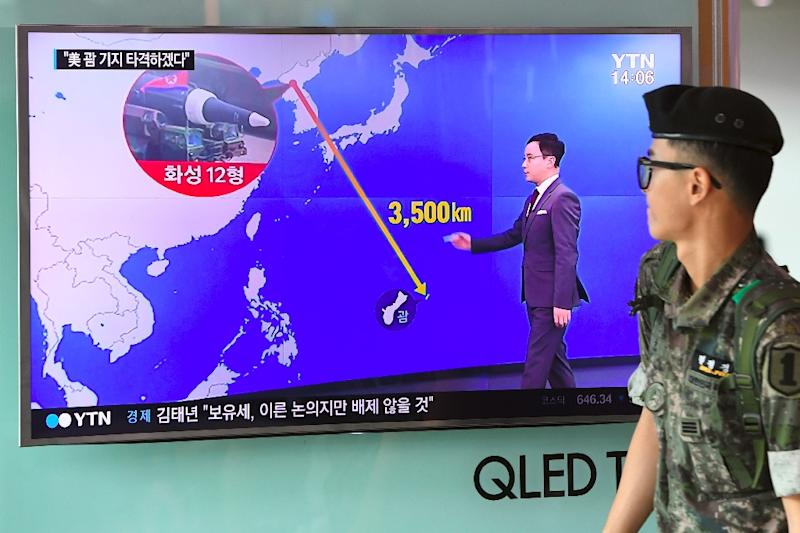 A graphic shows the distance between North Korea and Guam at a railway station in Seoul, South Korea (AFP Photo/JUNG Yeon-Je)